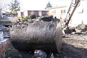 Removal of above and underground storage tanks on Contaminated land